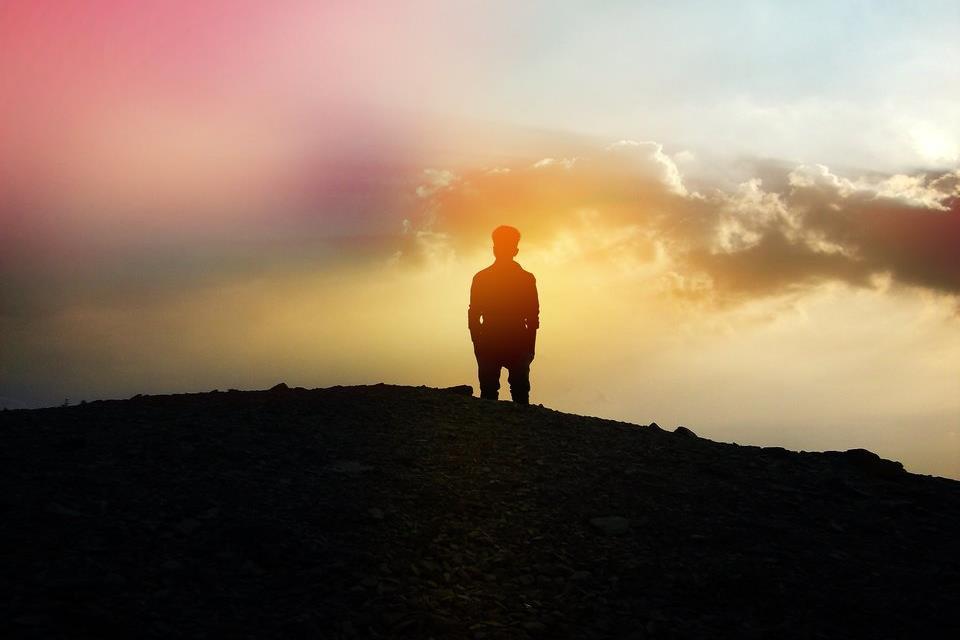 Man staring into sunset