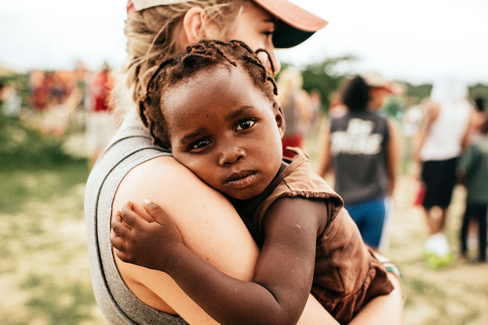 Woman holding a child in Haiti