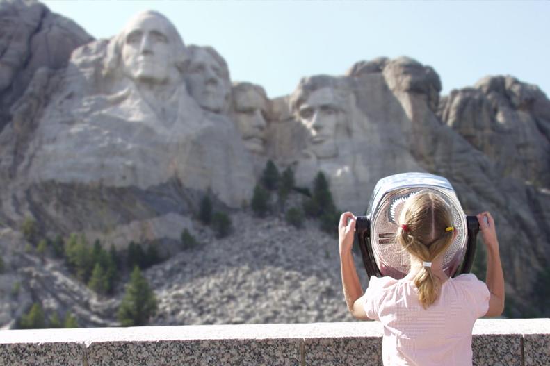 girl-looking-at-mount-rushmore