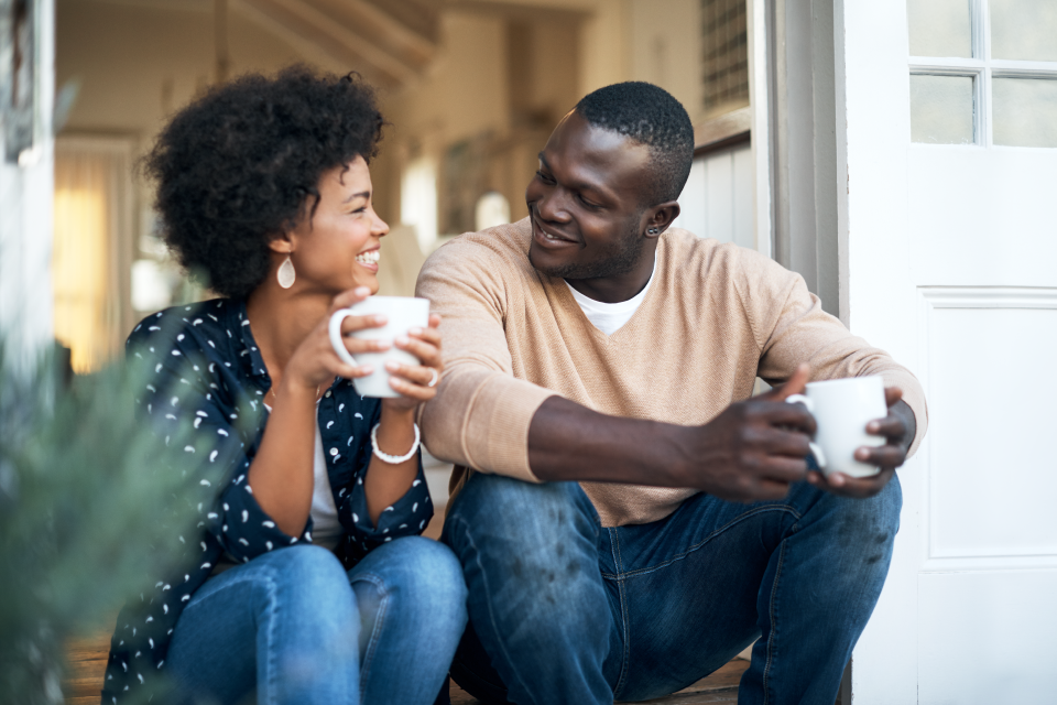 two-people-sitting-down-enjoying-coffee