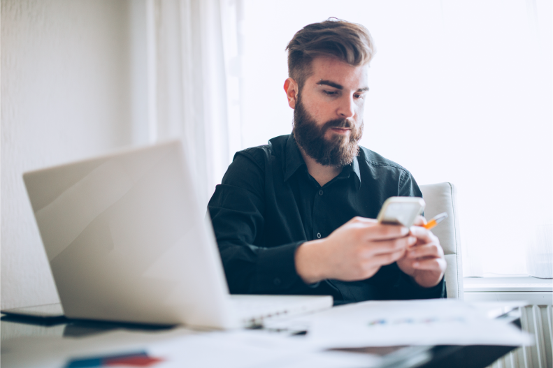 Young man using iPhone